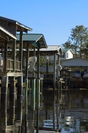 Boat houses on the canal in Suwannee, Florida.