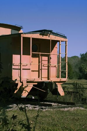 An old caboose sits on permanent tracks. Stock fotó