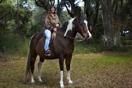 A woman rides a beautiful Arabian stallion.
