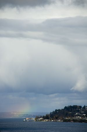 manifests: A rainbow manifests itself near Tacoma, Washington on the Puget Sound.