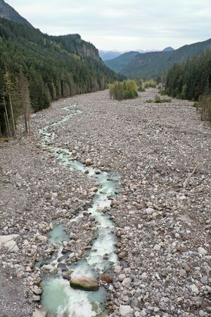 runoff: Nisqually River, Glacial Runoff River in Mount Rainier National Park. The riverbed is wide and rocky to accommodate huge spring melts of the glaciers on Mount Rainier. Stock Photo