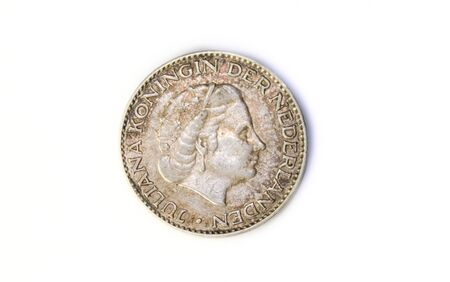 A 1956 Netherlands Juliana Silver Gulden Coin, obverse side. Circulated condition.