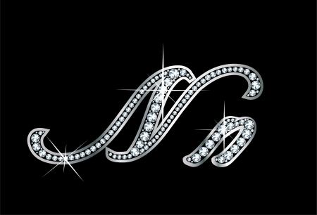 Stunningly beautiful script N and n set in diamonds and silver.