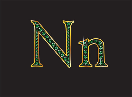 Nn in stunning emerald precious round jewels set into a 2-level gold gradient channel setting, isolated on black.