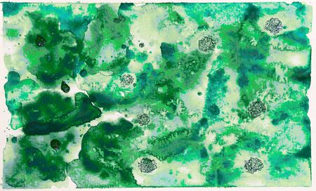 Abstract green colorful watercolor wash with the salt technique.