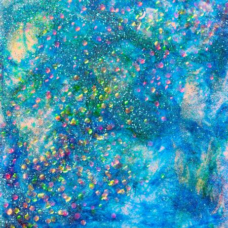 エポキシと染料のいくつかの層で青とホログラフィックのチャンキーグリッターは、素晴らしい輝く背景を作成します。 写真素材