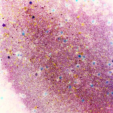 Abstract glitter design with pink and purple glitter, gold hearts and holographic chunky pieces for a sparkling background..