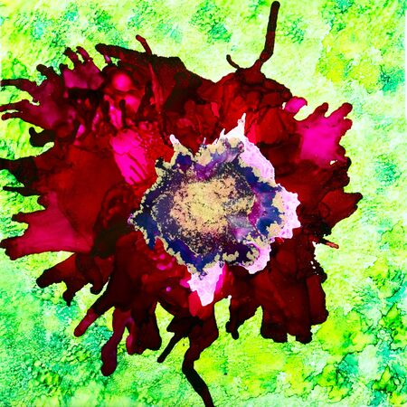 Abstract red poppy done in alcohol inks with gold mica in the center. Stock Photo
