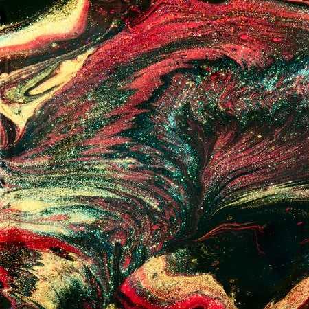 Abstract glitter design with red, gold and black glitter, in a poured fluid art design.