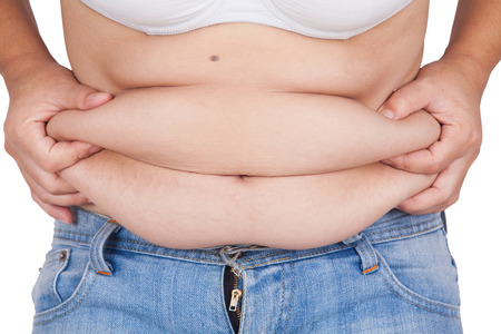 hands on stomach: abdominal surface of fat woman on white background