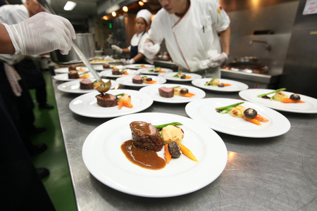 fine dining: Chef in hotel or restaurant kitchen cooking for dinner