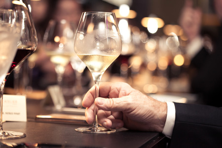 white wine on hand with dinner on restaurant Stock Photo - 43619851