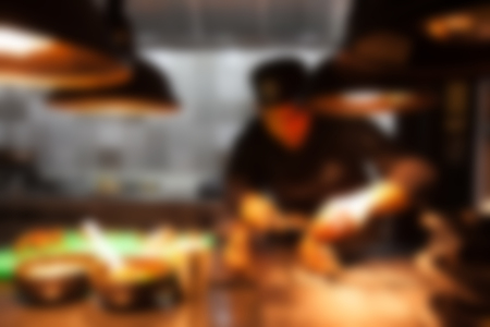 Blurry of Chef in hotel or restaurant kitchen indian style cooking for dinner