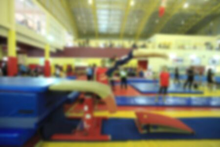 female gymnast: blurry of competition gymnastics of kid Stock Photo