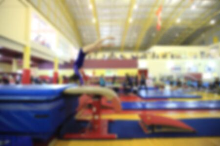 blurry of competition gymnastics of kid Stock Photo
