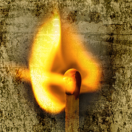 igniting: Match and blaze of fire overlap with old wall textured background. retro filter.