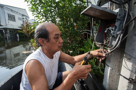 thailand flood: Nonthaburi flood in Thailand 2011-The lifestyle of people in massive flooding, Nonthaburi in Thailand, October 21, 2011 Editorial
