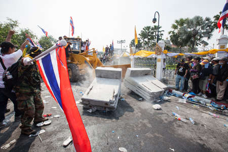 political and social issues: BANGKOK-December 9 : The Thai people protest against the government of Yingluck Shinawatra destroy barrier together on the road around Government House  on December 9, 2013 in Bangkok, Thailand.