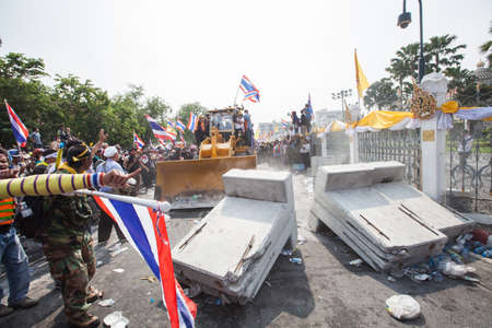 BANGKOK-December 9 : The Thai people protest against the government of Yingluck Shinawatra destroy barrier together on the road around Government House  on December 9, 2013 in Bangkok, Thailand.