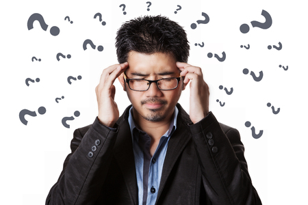 Asian businessman headache and him has strain with problem all around him.