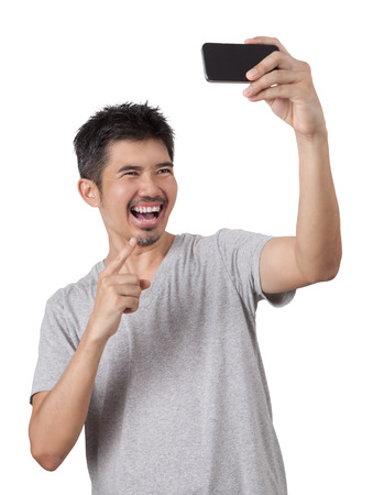 vdo: Selfie and video conference Top view of asian man and smiling while standing against white background