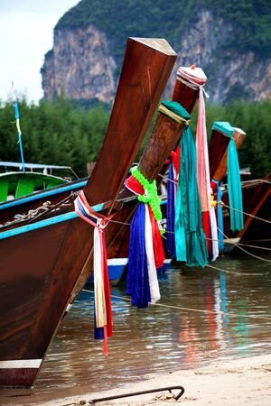 trawl: Colorful cloth tied on head of fishing boat is belief of fishermen in Thailand.