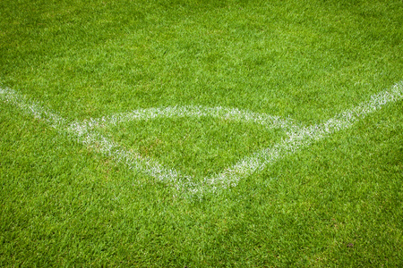 conner of football field with green grass