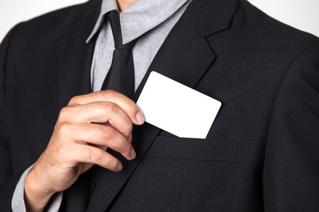 smartness: A Businessman takes a card out of his suit. Stock Photo