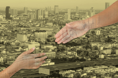 Hands is part of body woman and kid  for helping with cityscape background and yellow tone.