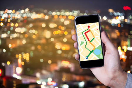 Hand Of Man Using Map On Smartphone Application With Bokeh