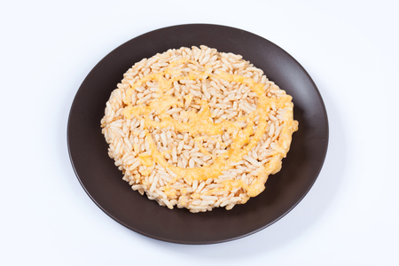NangLet is a name of rice cake round and flat sweetmeat is a dessert in Thailand, Put on brown plate on white background isolated.