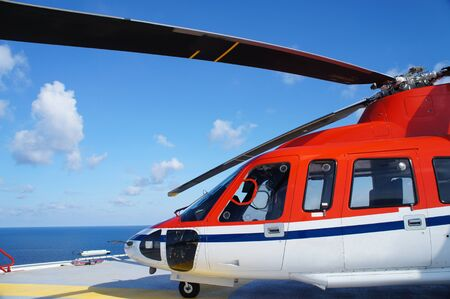 Helicopter Landing on The Offshore Drilling Rig for Crew Change Day Editorial