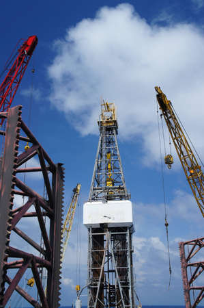 offshore jack up rig: Offshore Drilling Rig (Jack Up Rig) With Rig Cranes on Sunny Day - The View From The Bow Leg of The Rig Stock Photo