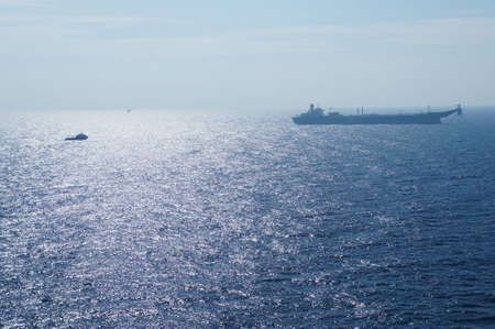 Offshore Tanker and Crew Boat in The Middle of The Sea photo