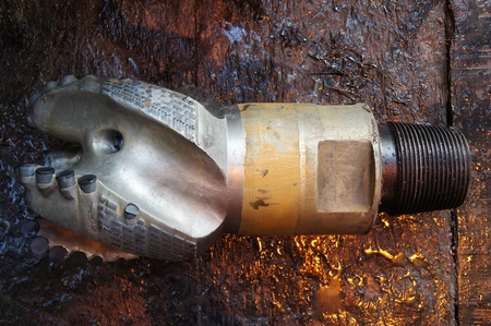 oilfield: Damaged PDC drilling bit just pulled out of hole