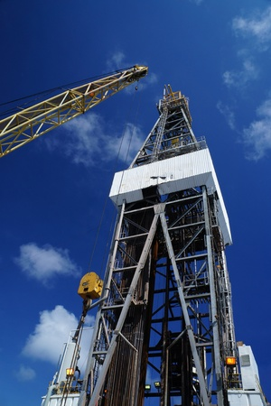 well platform: Offshore Drill Rig and Rig Crane with Blue Sky