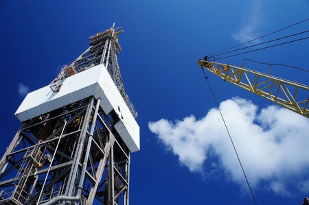 offshore jack up rig: Derick of jack up drilling rig with the rig crane on sunny day Stock Photo