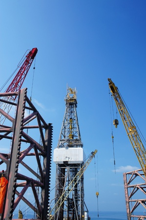 helideck: Offshore Drilling Rig (Jack Up Rig) With Rig Cranes - Petroleum Industry Stock Photo