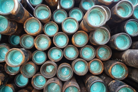 wells: Stack of oil well casing bundles at the pin end of casing Stock Photo
