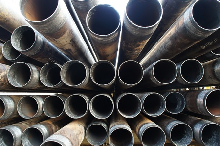 oilfield: Stack of casing laying on the deck            Stock Photo