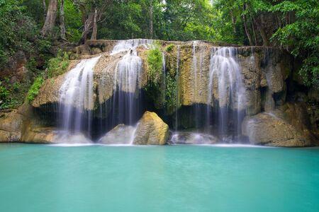 Deep forest waterfall (Erawan Waterfall) in Thailand photo