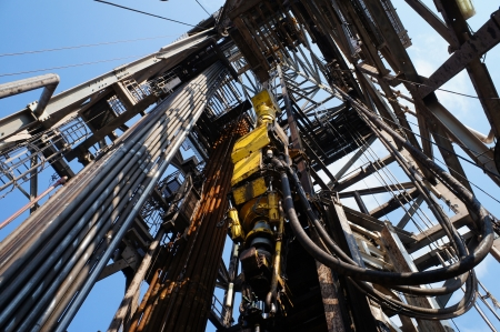 Top Drive System (TDS) and Derrick of Oil Drilling Rig photo