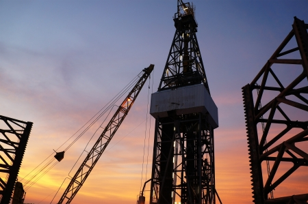 drilling rig: Jack Up Drilling Rig (Oil Drilling Rig) During Twilight Time Stock Photo