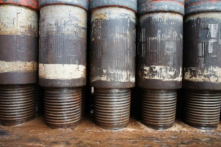 drill floor: Row of Tool Joint at Pin End of Drillpipe Standing On the floor Stock Photo