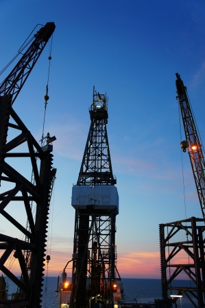 Silhouette Image of Jack Up Drilling Rig (Oil Rig) at Twilight Time photo