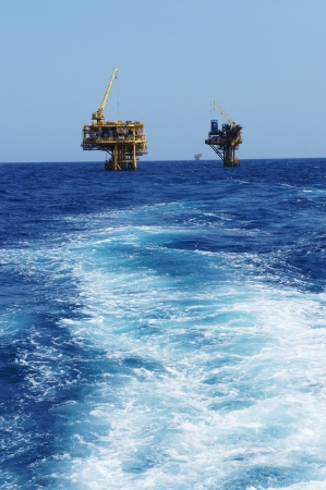 Two Offshore Production Platforms For Oil and Gas Development in The Ocean photo