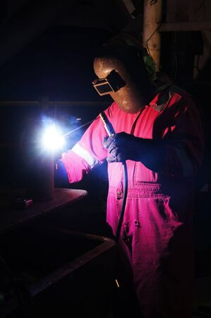Skilled Rig Welder Working on Fabrication Project photo