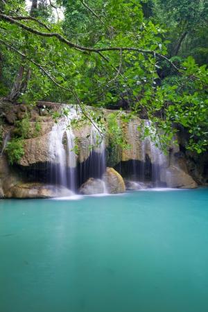 Deep forest waterfall - Erawan Waterfall in Kanchanburi, Thailand photo