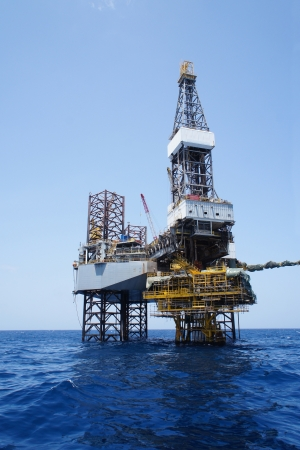 drilling well: Offshore Jack Up Drilling Rig and The Production Platform for Oil and Gas Production
