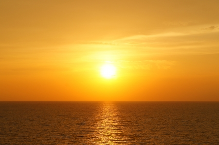 Golden Sun Set in The Middle of The Ocean                      photo